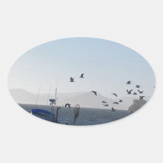 Kite on the beach oval sticker