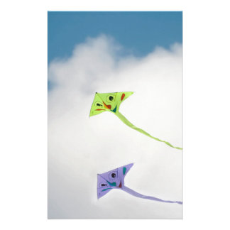 Kites floating in the blue sky with clouds stationery