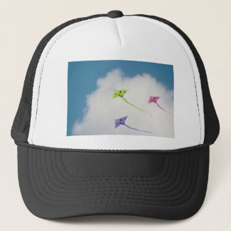 Kites floating in the blue sky with clouds trucker hat