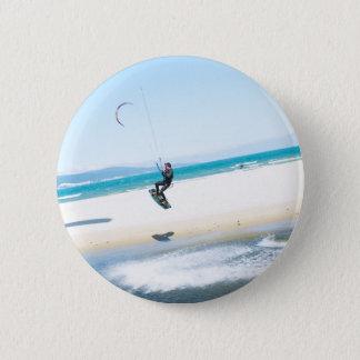 Kitesurfer boosts an air button
