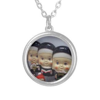 Kitschy Bobble-Head Nuns Pendants