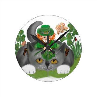 Kitten and Leprechaun Find a Four Leaf Clover Round Clock