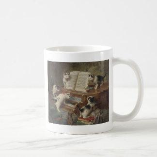 Kitten and piano coffee mug
