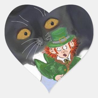 Kitten Grabs at a Leprechaun Heart Sticker