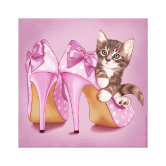 Kitten in purple shoe canvas print