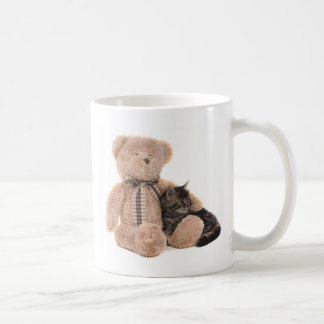kitten in the arms off has teddy bear coffee mug