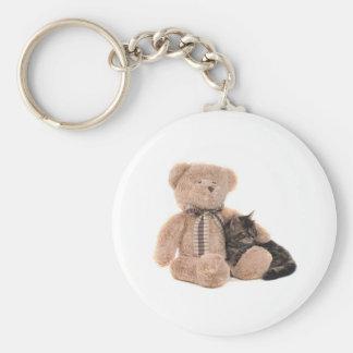 kitten in the arms off has teddy bear keychain