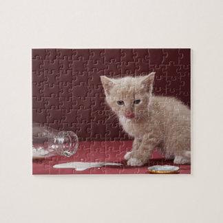 Kitten licking spilt milk from bottle jigsaw puzzle