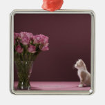 Kitten looking at vase of roses christmas tree ornament