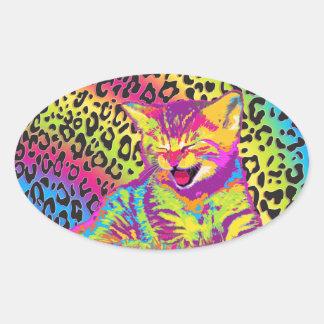 Kitten on rainbow leopard print background oval sticker