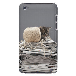 Kitten sitting on pile of newspapers iPod Case-Mate case