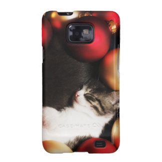 Kitten sleeping in decorations galaxy SII covers