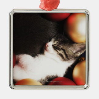 Kitten sleeping in decorations square metal christmas ornament