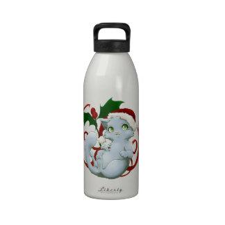 Kitten with santa hat drinking bottles