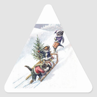 Kittens in the Snow Getting a Christmas Tree Triangle Sticker