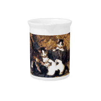 Kittens playing in a basket beverage pitcher