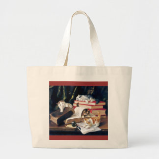 Kittens playing on a desk tote bag