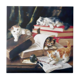 Kittens playing on a desk ceramic tile