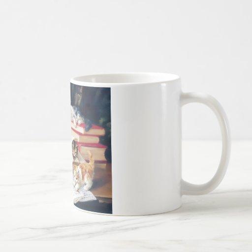 Kittens playing on a desk classic white coffee mug