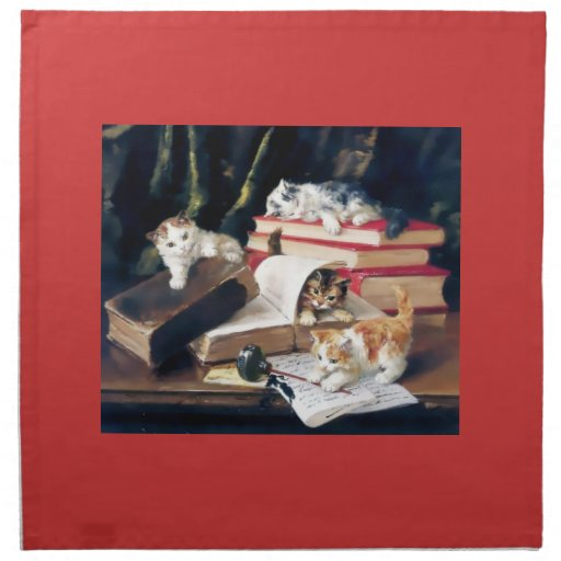 Kittens playing on a desk cloth napkins
