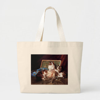 Kittens playing with a sewing box painting bags