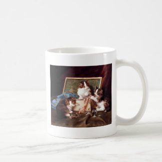 Kittens playing with a sewing box painting coffee mug