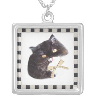 kitty in a checkerboard frame necklace