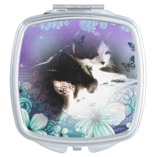 kitty surrounded by purple and blue flowers vanity mirror