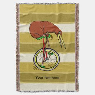Kiwi Peddling  A One Wheeled Bicylce Throw Blanket