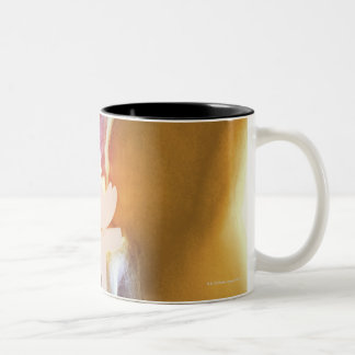 Knee replacement. Coloured X-ray of a total knee Two-Tone Coffee Mug