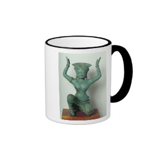 Kneeling feminine figure  used to support a mug