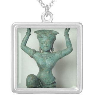 Kneeling feminine figure  used to support a silver plated necklace