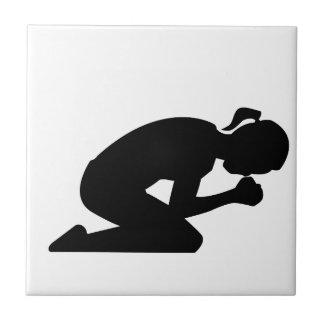 Kneeling in Prayer. Pray Hard Tile