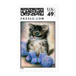 Knitting kitten in socks postage stamps