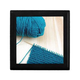 Knitting with teal yarn gift box