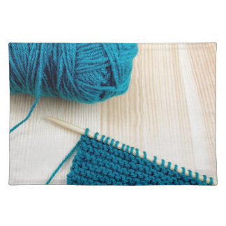 Knitting with teal yarn cloth placemat