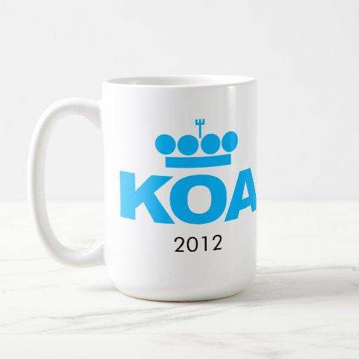 """KOA 2012 - """"aludes de lodo """" Taza Básica Blanca"""