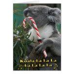Koala australiana del navidad con el bastón de tarjeta de felicitación
