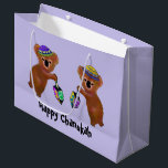 """Koala Chanukah Gift Bags<br><div class=""""desc"""">Graphic illustration of Koala bears playing dreidels for Chanukah. Celebrate all eight nights with this fun, animal art, design. These gift bags are made with premium quality paper and printed with vivid ink to make gift giving truly special. Available in four sizes and your choice of matte or glossy finish....</div>"""