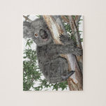 "Koala in a Tree Jigsaw Puzzle<br><div class=""desc"">A koala climbing a limb in a tree</div>"