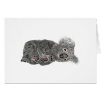 Koala que se acuesta tarjeta de felicitación