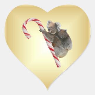 Koalas australianas del navidad en el bastón de pegatina en forma de corazón