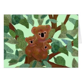 Koalas en la tarjeta del eucalipto