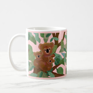 Koalas en la taza de la salida del sol del