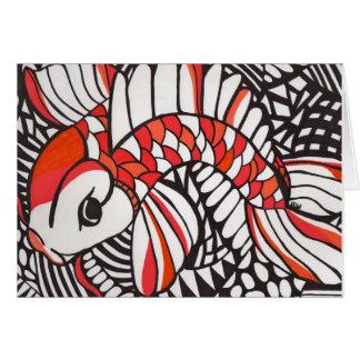 Koi anaranjado en tarjeta en blanco