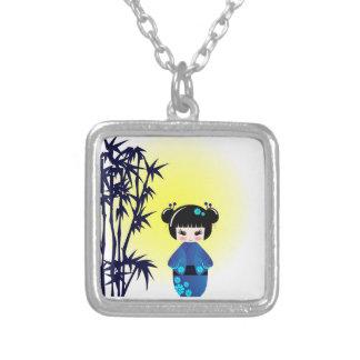 Kokeshi doll and bamboo necklace