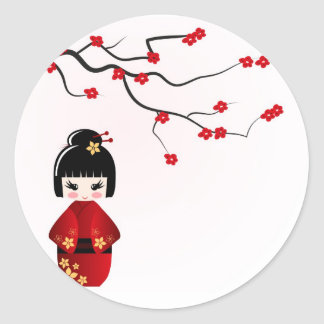 Kokeshi doll under sakura branch classic round sticker