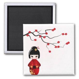 Kokeshi doll under sakura branch refrigerator magnet