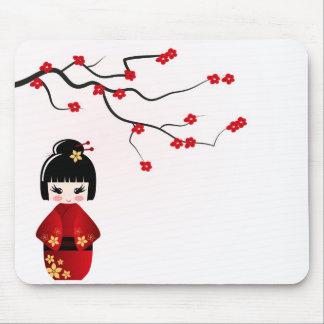 Kokeshi doll under sakura branch mousepad