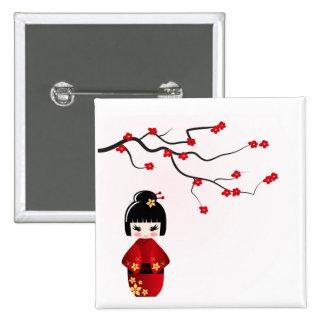 Kokeshi doll under sakura branch pinback button